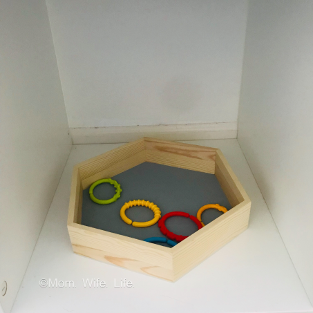 basket with 5 colorful baby link toys