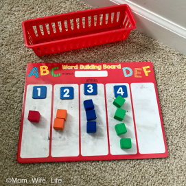 red 5 column board with counting cubes montessori