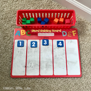 red 5 column board with magnetic numbers and counting cubes montessori