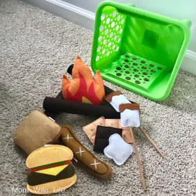 fire place toy set in green basket