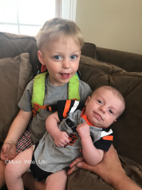 toddler boy and baby brother